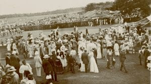 Photograph showing both British and Sri Lankan people milling around in their best attire at the races
