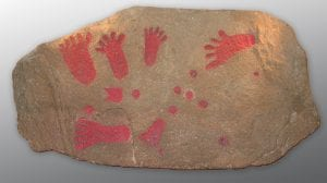 The Pool Farm Cist Slab - a stone slab covered in red footprints