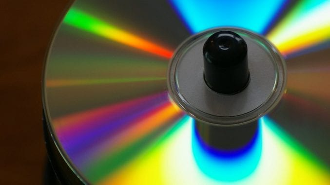 A CD reflecting back coloured light
