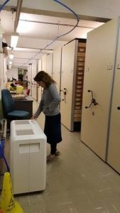 Our geology curator stood in the geology store monitoring a humidifier