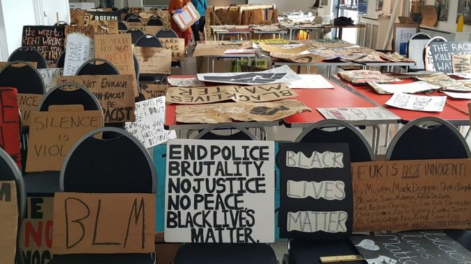 Hundreds of banners from the Black Lives Matter march in Bristol laid out in M Shed