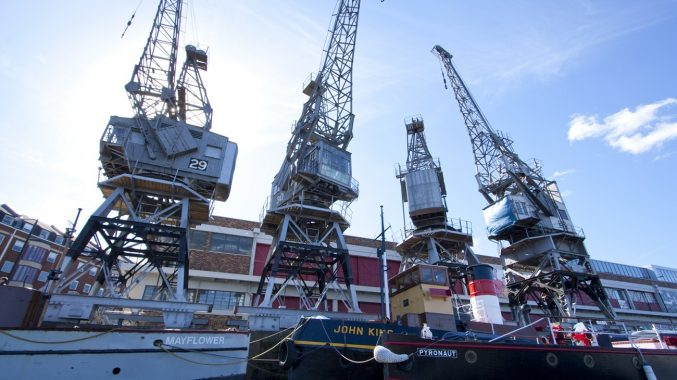 All four of the M Shed cargo cranes alongside boats in the Bristol harbour