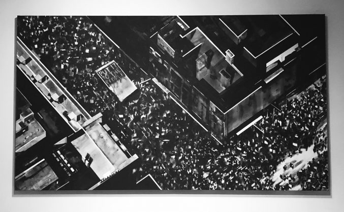 A black and white painting of a protest by Joy Gerrard