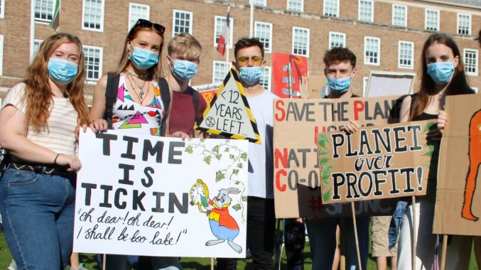 A photograph of a people from extinction rebellion with placards