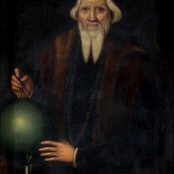 portrait of an elderly Sebastian Cabot holding compass next to globe.