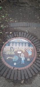 A mosaic of a scene featuring a person with a placard standing in front of a digger
