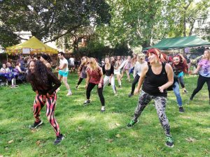 A group of women dancing in a park