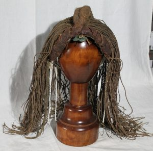 Woman's wig made from plant fibre, with long plaited braids. Botswana.