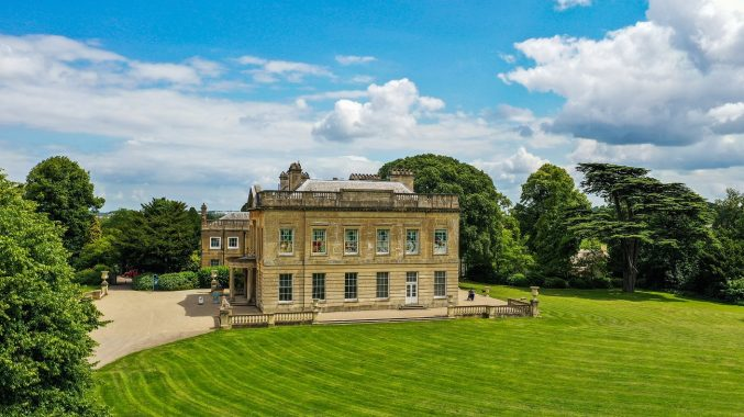 A grand mansion set within landscaped gardens