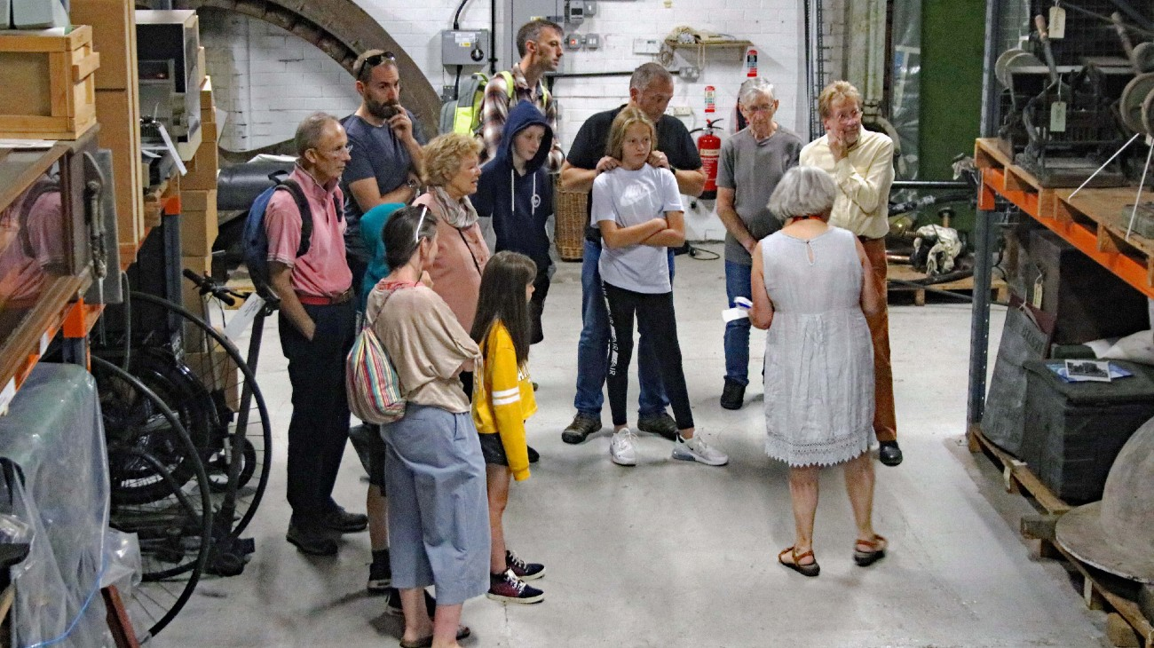 Group of visitors on a tour of the museums collection at M Shed