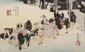 A Japanese Print by Hiroshige showing the changing of horses and porters at Fujieda, the twenty-second station along the Tokaidō Road, the main road that connected Kyoto to Edo, old Tokyo