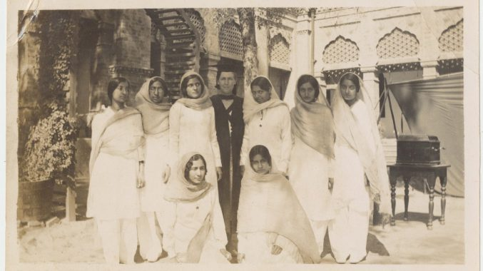 Senior Indian Students wearing white shalwar kameez of Queen Mary College, Lahore, with their European Principal, 1933