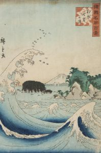 A Japanese print depicting a wave in front of a forest-covered Enoshima island and the snow-capped peak of Mount Fuji in the distance