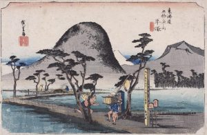 A Japanese Print of a landscape with a courier (hikyaku) running in the foreground